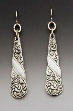 """The exquisite scrollwork cascading down these antique inspired earrings was inspired by rare silverware patterns from the late 1800s. Length: 1 1/2"""" Width 1/2"""" silver plate silver fill ear wire Made i"""