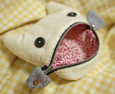mairuru: A cat eating a fish pouch - no pattern, but it's a good bit of inspiration!