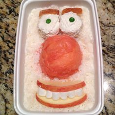 Funny Face (Eyes: Bagel, Cream Cheese and Peas - Eye Brows: Bread - Nose: Lox - Face: Rice - Mouth: Apple, Honey and Marshmallows)