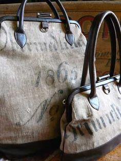 Bags made from vintage/antique linen feed sacks. Love the repurposing of something mundane into something so elegant.
