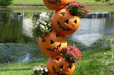 plastic pumpkin planters   TIPSY PUMPKIN PLANTERS with plastic pumpkin candy buckets