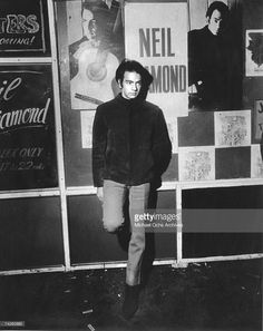 Singer Neil Diamond poses for a portrait in front of a marquee advertising a club where he is performing an engagement in circa 1967.