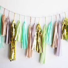 Tissue Tassel Garland in Gold, Mint, Lime Green - Whether you're planning a birthday party, a baby shower, or decorating a nursery...we adore how functional and stylish this handmade tassel garland is! Scoop your's up now because they sell quickly!