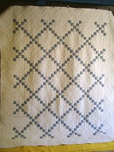 This single Irish Chain was made to look like a vintage quilt. It was pieced by Mary M Scott and quilted by Nancy Scott at Masterpiece Quilting.