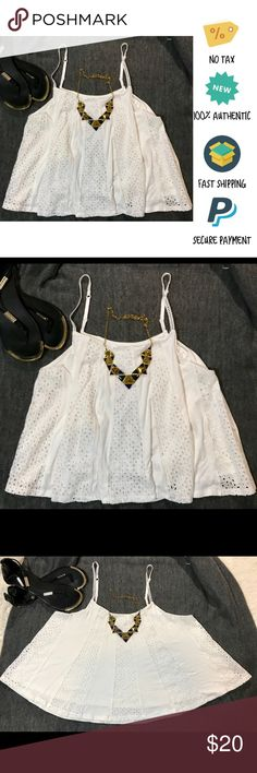 Rue 21 White Mixed Eyelet Spaghetti Strap Tank Top Rue 21, White, Mixed Eyelet Spaghetti Strap Tank Top, Small  Item Condition: New with tags. Please review measurements to assure a perfect fit! Product shipped from smoke, animal, and child-free environment.   •Sleeveless •Adjustable spaghetti straps •Relaxed, pullover style •Materials: Shell: 100% Rayon, Crochet: 100% Cotton, Lining: 100% Rayon Rue21 Tops Tank Tops