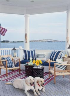 39 Wonderful Sea And Beach-Inspired Patios : 39 Cool Sea And Beach Inspired Patios With White Blue Sofa Pillow Chair Table Flower Decor And Red Carpet With Dogs And Hardwood Floor And Sea View