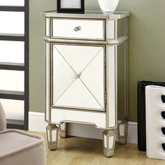 Monarch Rectangular Mirrored 1 Drawer Accent Cabinet - If your space could use a little glamour, this Monarch Rectangular Mirrored 1 Drawer Accent Cabinet will provide plenty. This beauty is accented by...