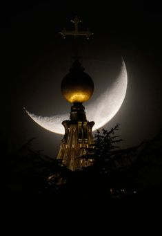 The moon is seen behind a dome of St Peter's Basilica at the Vatican.  Picture: Dmitry Lovetsky/AP