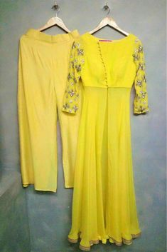 The Stylish And Elegant Palazzo Pant Suit In Yellow Colour Looks Stunning And Gorgeous With Trendy And Fashionable Fabric Looks Extremely Attractive And Can Add Charm To Any Occasion. Party Wear Indian Dresses, Designer Party Wear Dresses, Indian Fashion Dresses, Kurti Designs Party Wear, Kurta Designs, Indian Outfits, Blouse Designs, Stylish Dresses, Simple Dresses