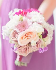 While each attendant's bouquet was unique, all of them featured pops of dark and light pinks to match their gowns.