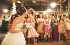 Beautiful Picture of bride preparing to throw her bouquet