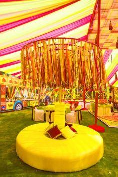Design & Decor by Dinaz , mehendi , decor , fun , colourful , canopy , ribbons , pink , yellow , green , couches , sangeet , wedding decor , bar , truck ,  rajasthani