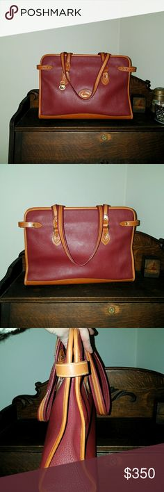 Vintage vtg Dooney & Bourke r41 shopper tote Rare r41 shopping tote. Rouge  with BT trim, in very good used condition.  Perfect size for a brief case, computer bag, book bag, etc.  A couple of flaws , very minor scuffs at the corner trim and base,  and a tiny spot on the base, see pics . The original edge coat is intact,  meaning the bag was not used much. Duck  fob is included and is immaculate, solid brass hardware  2 large interior pockets . Smoke free environment  pet friendly home  17 L…