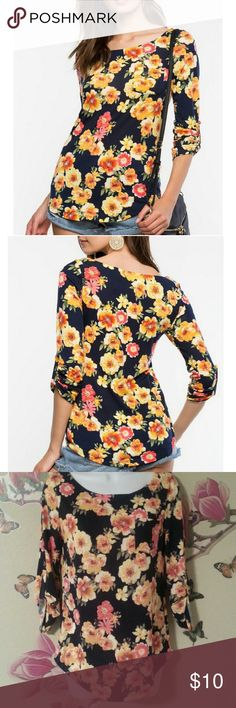 "NWT Alana Floral Boatneck Brand New with Tags Spring it on in this bright casual tee, featuring a floral print and a boat neck, single chest pocket. Three-quarter sleeves with button tabs. . Measures approx. 24"" length, 32""chest, 28"" waist, 17"" sleeve length . 95% Polyester, 5% Spandex . Hand wash cold . Model is in size S . Model is 5'9"", 32"" bust, 23"" waist, 34.5"" hips Color: Blue Pattern DNA  Couture Tops Tees - Short Sleeve"