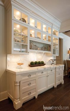 Cabinetry pulls double duty for storage and presentation