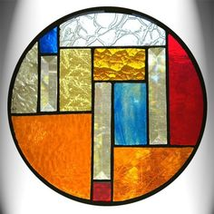 Stained Glass artist Angela Smith. http://www.etsy.com/listing/32478665/round-amber-stained-glass-panel