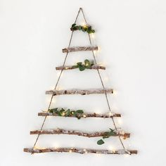 Birch Branch Hanging Christmas Tree. Crafted from natural birch branches and sprinkled in glitter snow, this hanging tree is perfect for creating a Scandinavian feel at home this Christmas.