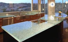 Glass counters also create a statement without taking away from the overall design of your space. Description from sheknows.com. I searched for this on bing.com/images