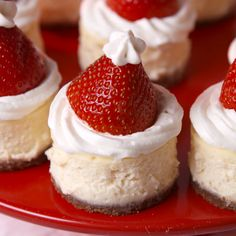 When Santa makes his list and checks it twice this year, we plan to be right at the top: these mini Santa cheesecake bites are the easiest way to show just how nice you are. Get the recipe at Delish.com. #delish #easy #recipe #cheesecake #bites #santa #hat #strawberry #hack #dessert #holiday #christmas