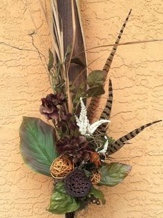 Palm Tree Seed Pod with Silk Flowers, Feathers, Pods and Dried Branches