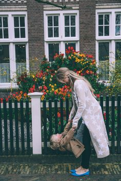 Barefoot Blonde Amber Fillerup wearing Mara Hoffman and J. Crew in Amsterdam