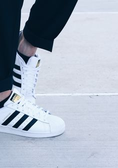 Classic adidas Shell Toes - Tags: sneakers, low-tops, navy blue, cuffed pants, white leather, gold tongue tag, on feet