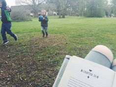 Playing football at the park this afternoon while Mama read  The Looking Glass Wars by Frank Beddor #booksatthecircus