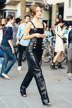 Black leather overalls with gold hardware detailing