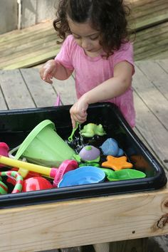 sand/water table made with cement tub! will definitely get the hubby to make!