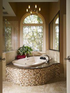Beautiful tub and window, bathroom interior design ideas and decor.