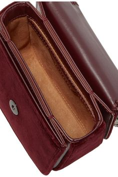 Burgundy velvet  Snap-fastening front flap Designer color: Aubergine Comes with dust bag Weighs approximately 1.8lbs/ 0.8kg Made in Italy