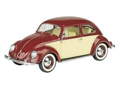 This VW Beetle Diecast Model Car is Red and Beige and features working wheels. It is made by Schuco and is 1:43 scale (approx. 9cm / 3.5in long).  ...
