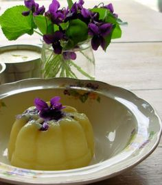 Violet Custard   Ingredients (Serves 6-8)   3/4 cup violets (petals only); 3 large eggs; 2 egg yolks; 1/2 cup sugar; 3 cups milk; 1 teaspoon vanilla.