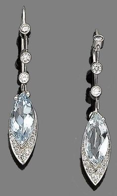 154319fa409 A pair of aquamarine and diamond pendent earrings Each navette-shaped drop  set with a marquise-cut aquamarine and brilliant-cut diamond highlights
