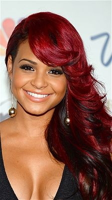 Christina Milian wowed crowds at the 2013 Miss USA Competition with her bright red hair and sexy cascading curls.