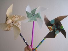 How To:   Paper Pinwheels  http://www.apartmenttherapy.com/how-to-paper-pinwheels-56022