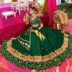 Redefining in bottle green lehenga with emroidered blouse and golden kaleeras to match her outfit. Indian Wedding Gowns, Desi Wedding Dresses, Indian Bridal Outfits, Indian Designer Outfits, Indian Dresses, Bridal Dresses, Choli Designs, Lehenga Designs, Mehndi Designs