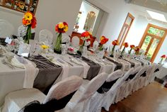 Long tables are very trendy at the moment.  This bride chose Gerberas for a bright, cheerful and fabulously fun look!