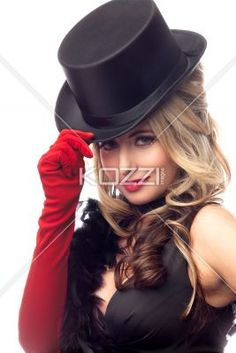 female fashion model posing with a hat. - Portrait of a attractive female fashion model posing with a hat over white background, Model: Nadine Yelovich
