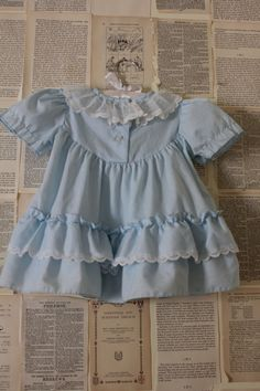 Vintage Baby Blue Dress - Retro White Lace Ruffle Gown with Collar and Tiny Pink Bow - Baby Clothes Clothing - Newborn Shower Gift. $13.99, via Etsy.