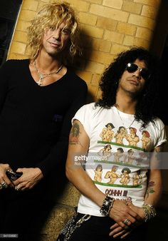 Duff McKagan (left) and Slash (Saul Hudson) from Velvet Revolver posed in the American Hotel, Amsterdam, Netherlands on March 23 2004