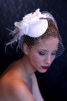 Sophisticated new bridal hat. So sweet and very feminine headpiece, wedding hat. Made from flowers, crystals, feathers and veil. Hat base sinamay or