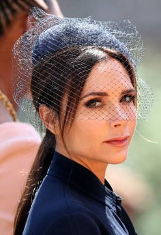 British singer and fashion designer Victoria Beckham leaves after attending the wedding ceremony of Britain's Prince Harry Duke of Sussex and US...