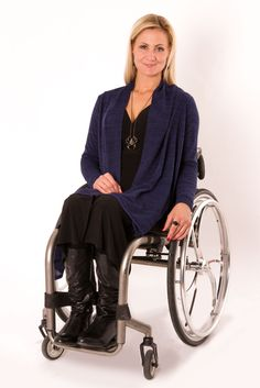 Wrap Dress by Izadaptive looks great. Would love to know the brand of the wheelchair, it looks a lot less clunky than my Quicky2. Wheelchair fashion