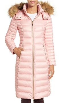 A long, shapely silhouette in pink and a signature bow beneath the back collar imbue this channel-quilted down jacket with signature Kate Spade femininity.