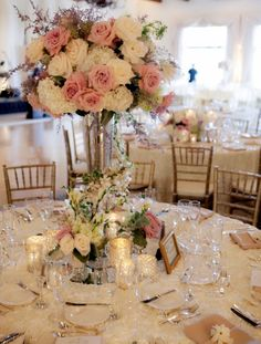 Tall wedding centerpieces - At the base of the centerpieces, collections of mercury glass votives and small florals including roses, freesias, dusty miller and variegated ivy filled the table A fresh gardenia was placed on eac Tall Wedding Centerpieces, Wedding Table Centerpieces, Reception Decorations, Centerpiece Ideas, Trumpet Vase Centerpiece, Tall Centerpiece, Martini Glass Centerpiece, Quince Centerpieces, Manzanita Centerpiece