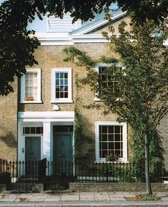 Alistair Green and Lesley Hinder's 19-Century London Home    The front door's historical blue shade fits right in with the home's façade.    Around the time the homeowners were fixing up their 1830s Georgian-style terrace house in Islington, North London, the downtrodden street underwent a renaissance, and now it's one of the most sought-after corners of London.