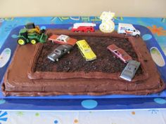 demolition derby cake - like the tractors, fire truck and ambulance at border