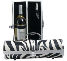 """Zebra Print Wine Purse    Featured in March 2010 issue of The Oprah Magazine on her """"O List""""    A classic design paired with a rich finish make these wine purses a snazzy wine carrier to the BYOB restaurant, perfect at an upscale social gathering, fashionable as a club purse on a night out with the girls, and with a corkscrew included and room for lipstick, keys and credit card – a girl is always prepared. Rests on four steel feet, buckle closure, elastic strap to keep bottle secure."""