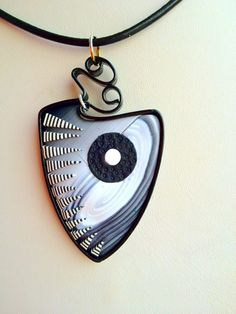 blackshield.jpg ~ I like how this one's wrapped with ribbon wire!  Inspiration